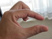 1の指で包む